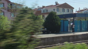 Green Nature, fast train window view , houses , 2016. Turkey ankara city from konya city tranport fast train stock video footage