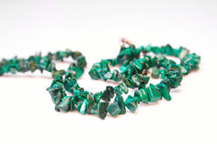 Green necklace 01. Green necklace with small beads on white Stock Photo
