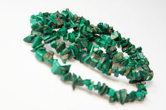 Green necklace 02. Green necklace with small beads on white royalty free stock photography
