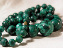 Green necklace. Pearl necklace royalty free stock image