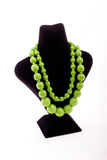 Green necklace. On black Mannequin Royalty Free Stock Image