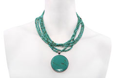 Green necklace on a mannequin Stock Photography