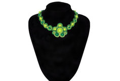 Green necklace on a rack Royalty Free Stock Photos