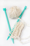 Green needles for knitting and wool Stock Images