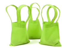 Green Neon Cloth Bags With Shadows Royalty Free Stock Images