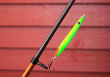 Green neon fishing hook on a fishing rod Royalty Free Stock Images