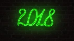 Green Neon signboard 2018 happy new year lighting up against a Brick wall royalty free illustration