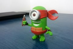 Green Ninja Turtle Minion. With red head band and smiling Royalty Free Stock Images