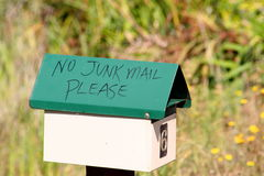 Green no junk mail mailbox. Green mailbox, with no junk mail written on it with a black marker Royalty Free Stock Images