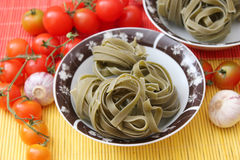 Green Noodles. Some italian green noodles made with spinach stock images
