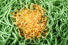 Green Noodles Closeup. Green noodle with Fried garlic Stock Photography