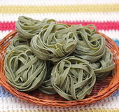 Green noodles. Some italian pasta made with spinach stock photography
