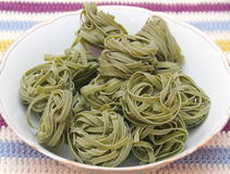 Green noodles. Some green noodles made of spinach royalty free stock photo