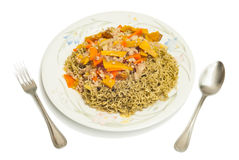 Green noodles topped with pork, carrots, pumpkin Royalty Free Stock Photography