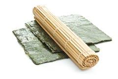 Green nori sheet and bamboo mat. Royalty Free Stock Photo