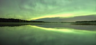 Green northern lights at night Stock Photo