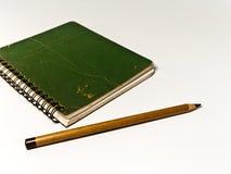 Green Note Book and Pencil Stock Photos