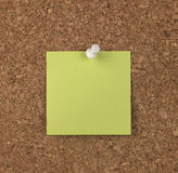 Green Note on Cork Board Stock Image