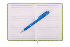 Green notebook and blue handle Royalty Free Stock Image