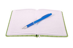 Green notebook and blue pen. Green notebook with blue pen isolated on white background with soft shadow Clipping path Royalty Free Stock Image