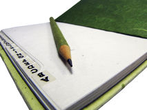 Green notebook and fine pencil-point, to organise. Stock Photos