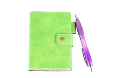 Green notebook and the pen Royalty Free Stock Photography