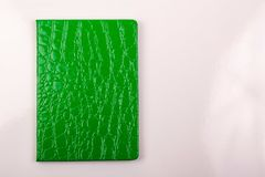 Green notebook with pen on white background royalty free stock images