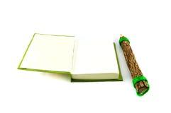 Green notebook and pencil Stock Photos