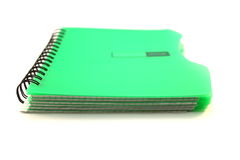 Green notebook on white background close. Up Stock Photo