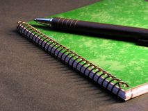 Green notepad. And black pen royalty free stock images