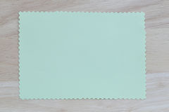 Green notepad paper of empty and copy space on wooden background Royalty Free Stock Images