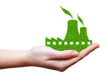 Green Nuclear power plant icon in hand. Isolated on white Royalty Free Stock Images