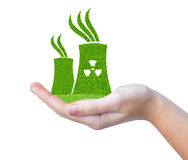 Green Nuclear power plant icon in hand Stock Photo