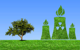 Green nuclear power plant icon on meadow . Royalty Free Stock Image