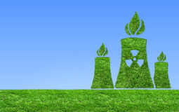 Green nuclear power plant icon on meadow . Royalty Free Stock Photos