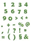 Green numbers and signs on white background. Green alphabet numbers and signs filled with broccoli Royalty Free Stock Photography