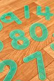 Green numbers on a wooden floor royalty free stock photo