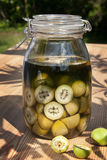 Green nut liqueur in the table Royalty Free Stock Images