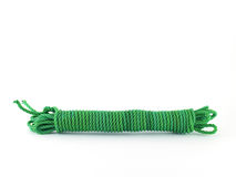 Coiled green nylon rope isolated on white background. Close up with copy space royalty free stock photos