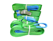 Green nylon soft lifting slings stacked in piles. Isolated on white background Stock Image