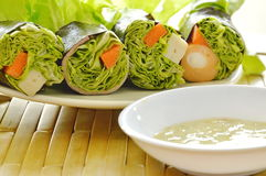 Green oak and sausage wrapped by seaweed with spicy mayonnaise sauce Stock Photos