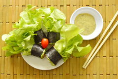 Green oak and sausage wrapped by seaweed with spicy mayonnaise sauce Royalty Free Stock Images