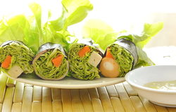 Green oak and sausage wrapped by seaweed with spicy mayonnaise sauce Stock Images