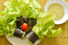 Green oak and sausage wrapped by seaweed with spicy mayonnaise sauce Royalty Free Stock Photography