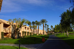 Green oasis with Palm trees. RANCHO MIRAGE, CALIFORNIA - DEC 20, 2014 - Southwestern style hotel buildings in green oasis with Palm trees, Rancho Mirage royalty free stock photos
