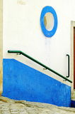 Green Obidos Handrail. Detail of a pitoresque wall painted in white and blue at the center of the old medieval town of Óbidos, Portugal Stock Images