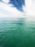 Green ocean water. Ocean with a nice contrast between green water and blue sky Stock Photos