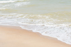Green ocean wave with white sand Stock Images