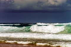 Green ocean waves in stormy wheather Stock Images