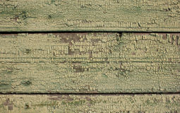 Green ochre shade coloured cracked paint peeling on wood texture.old wooden planks. Stock Photo